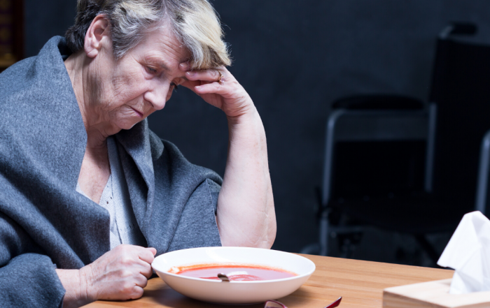 woman sitting at table alone with soup