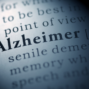 alzheimer written out in news print